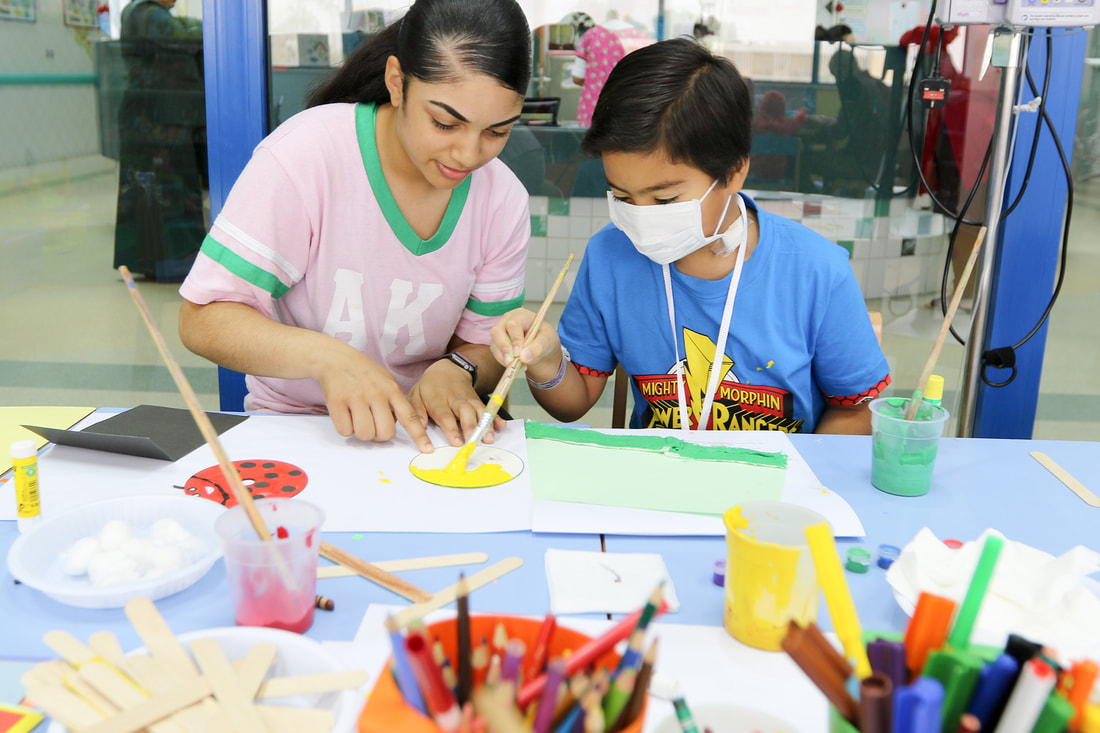 Middle school students learning art with safety masks